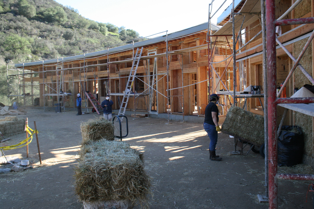 Straw bales are installed after wood framing is complete.