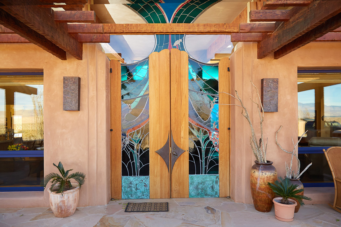 Stained glass double doors by James Hubbell. & Southwest Style Home Using Straw Bale